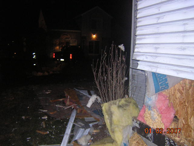 lost control hit house, took out fence and went in neighbors back yard